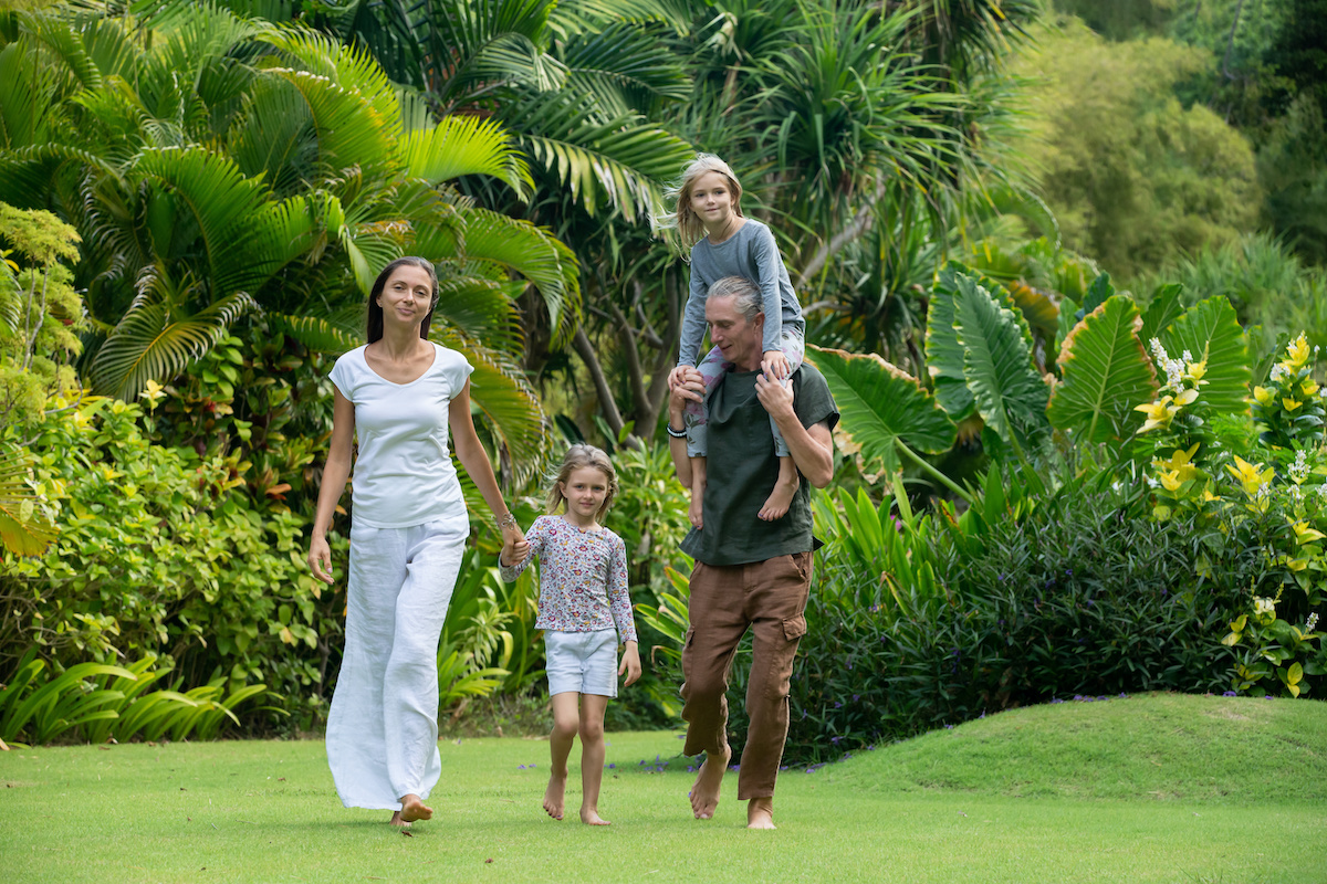 family walking through field of various palm trees - Florida Gardening Danger:  Poisonous Palm Trees